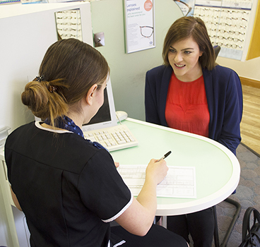 Girl at opticians appointment