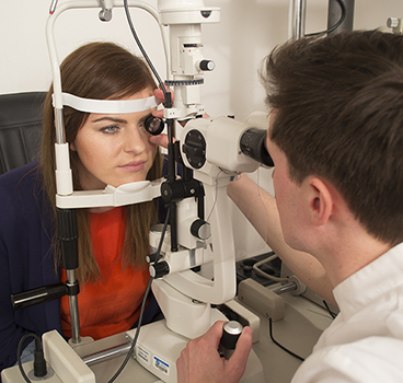 Girl having an eye test