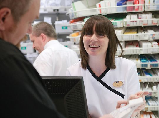 Boots pharmacist talking to customer