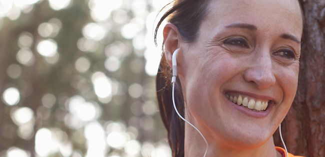 Female runner outdoors with headphones