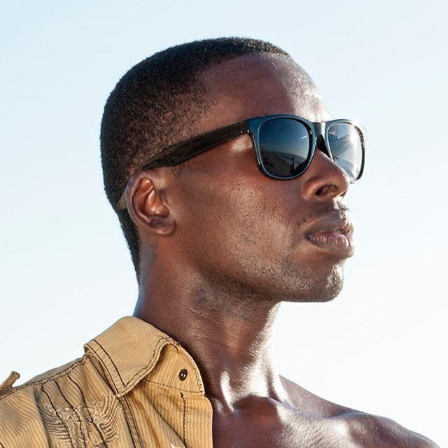 7bed4e9a85 Man wearing black sunglasses on beach