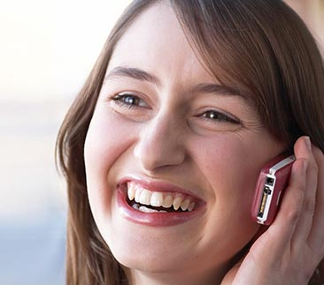 Woman smiling on her mobile phone