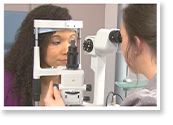 Optometrist carrying out an eye check