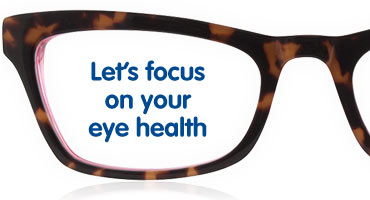 Pair of the glasses with writing featured in one lens saying: Let's focus on your eye health